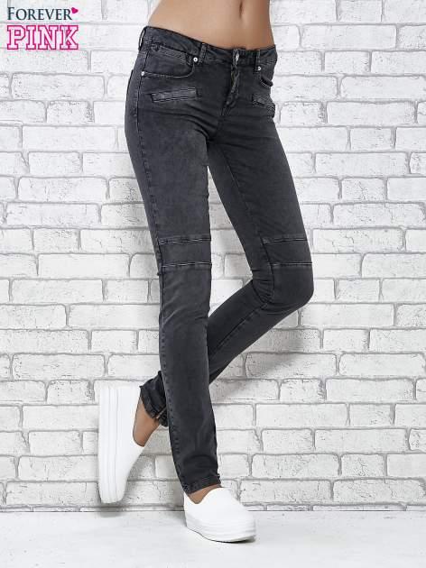 Ciemnoniebieskie skinny jeans z przeszyciami i suwakami