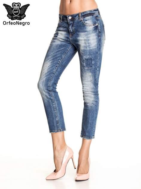 Ciemnoniebieskie spodnie skinny jeans z łatami                                  zdj.                                  1