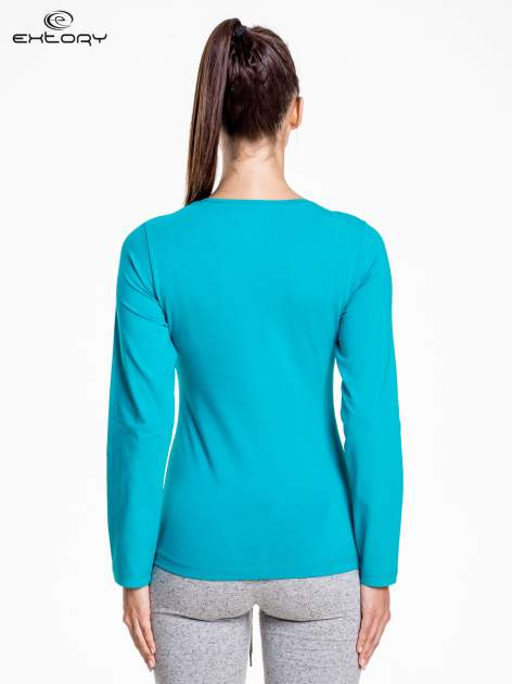 Ciemnoturkusowa bluzka sportowa z dekoltem V                                  zdj.                                  4