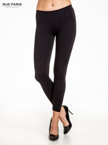 Czarna legginsy z dżetami wzdłuż nogawki