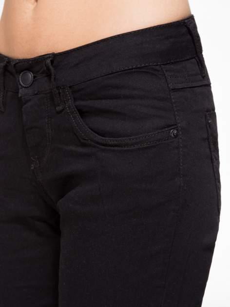 Czarne klasyczne spodnie jeansowe rurki                                  zdj.                                  5