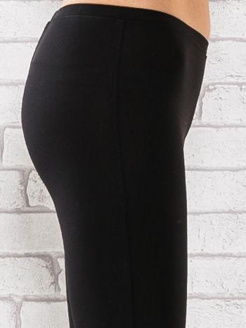 Czarne legginsy sportowe termalne z dżetami na nogawkach                                  zdj.                                  5