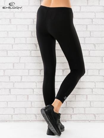 Czarne legginsy sportowe termalne z patką z dżetów                                  zdj.                                  3