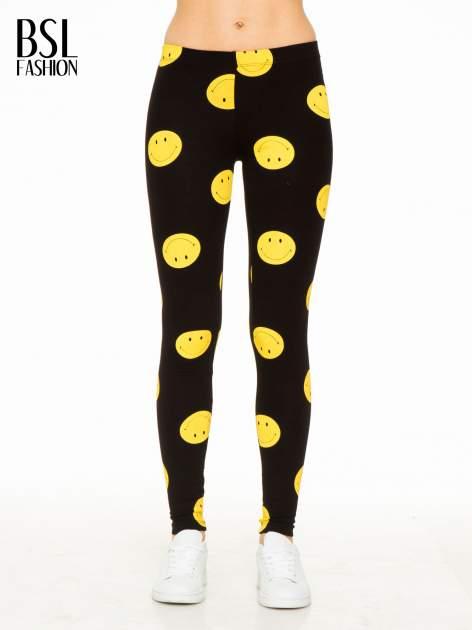 Czarne legginsy z nadrukiem uśmiechniętych buziek                                  zdj.                                  1