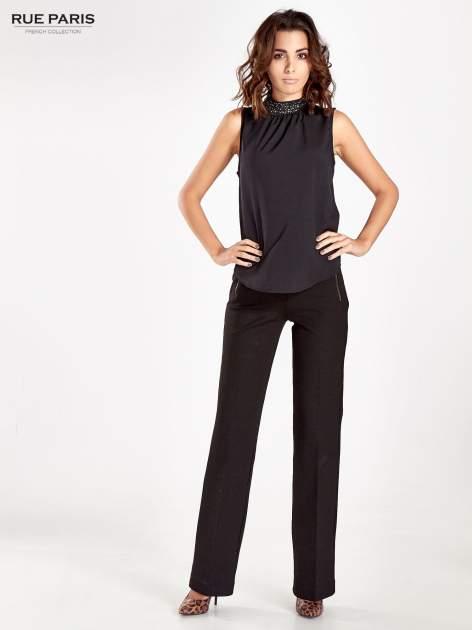 Czarne materiałowe spodnie dzwony w kant                                  zdj.                                  10