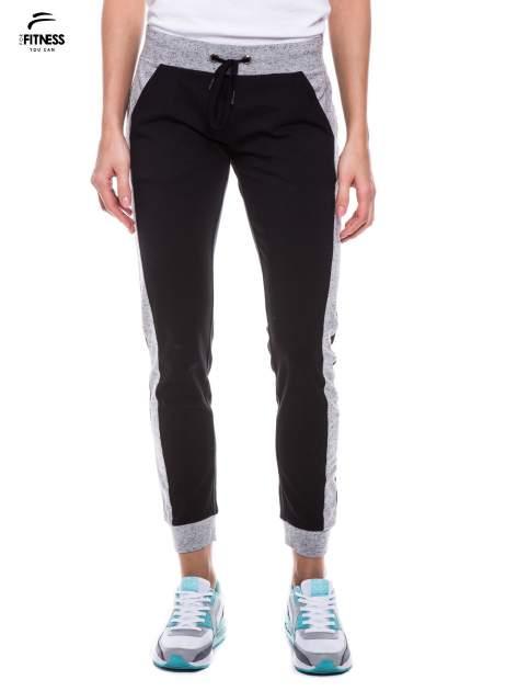 Czarne spodnie dresowe damskie z kontrastowymi lampasami po bokach                                  zdj.                                  1