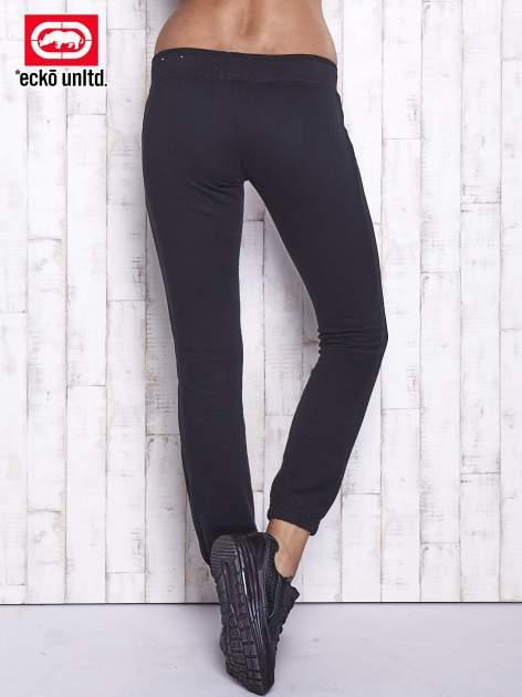 Czarne spodnie dresowe z cekinami                                  zdj.                                  3