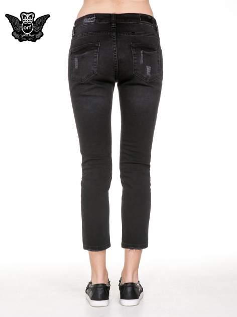 Czarne spodnie jeansowe 7/8 z rozdarciami                                  zdj.                                  6