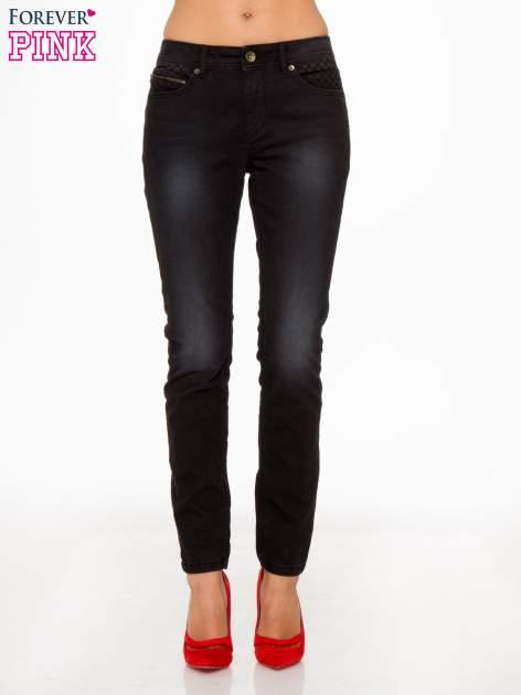 Czarne spodnie jeansowe rurki                                  zdj.                                  1
