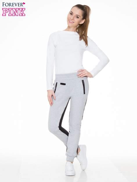 Czarno-szare spodnie dresowe two tone z kieszeniami                                  zdj.                                  2