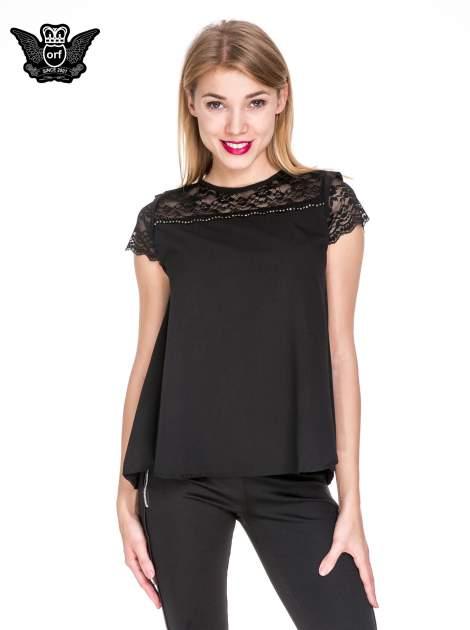 Czarny elegancki t-shirt z koronkową górą o kroju dzownka                                  zdj.                                  1