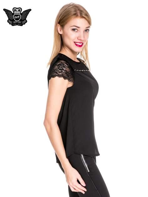 Czarny elegancki t-shirt z koronkową górą o kroju dzownka                                  zdj.                                  3