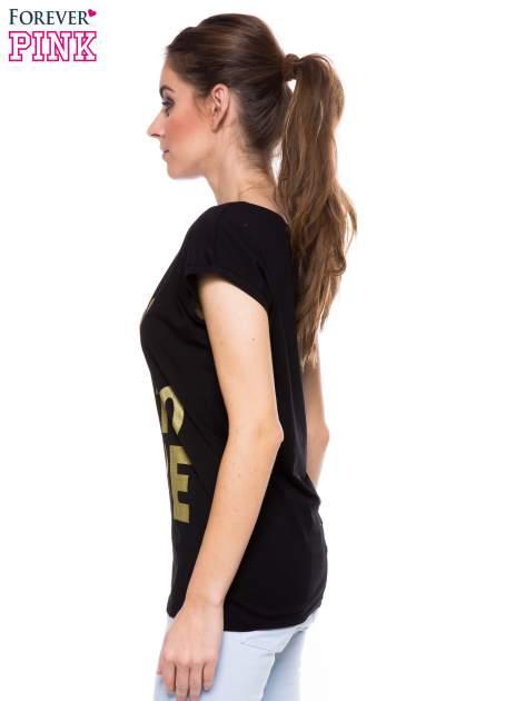 Czarny t-shirt ze złotym nadrukiem korony i napisem BORN TO SHINE                                  zdj.                                  2