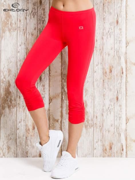 Czerwone legginsy sportowe 3/4 z marszczoną nogawką