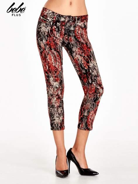 Czerwone spodnie skinny w kwiaty