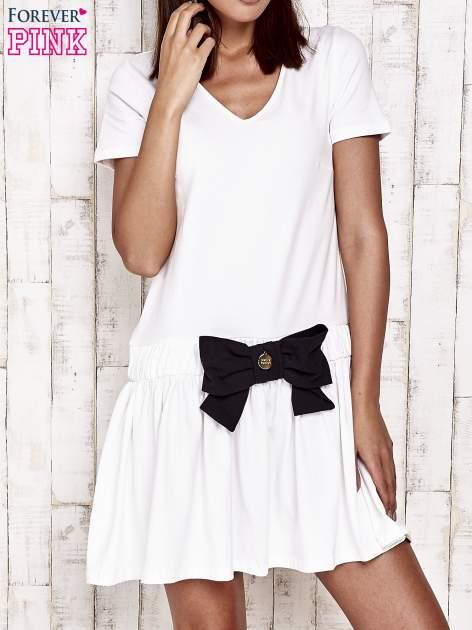Ecru sukienka dresowa z kokardą z przodu