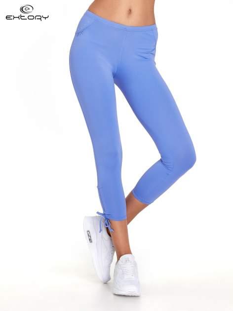Fioletowe legginsy sportowe termalne z dżetami i ściągaczem