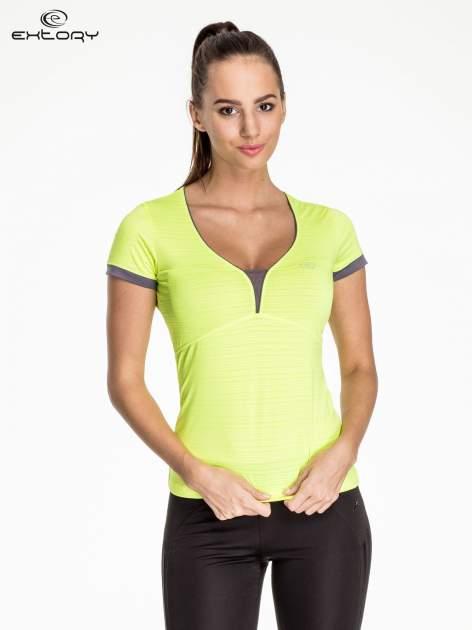 Fluożółty damski t-shirt sportowy w paski z lamówką                                  zdj.                                  1