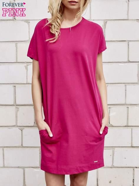 Fuksjowa sukienka dresowa z kieszeniami po bokach                                  zdj.                                  1