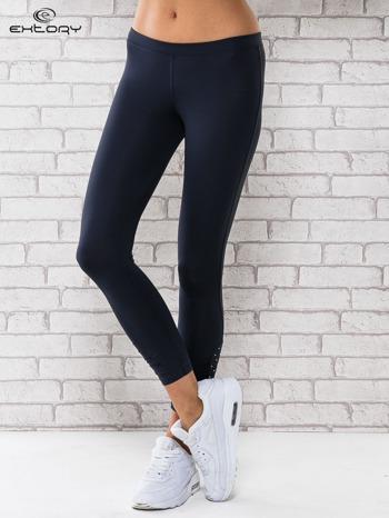 Grafitowe legginsy sportowe z dżetami na dole nogawki                                  zdj.                                  1