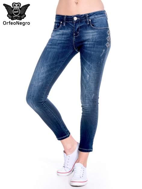 Granatowe spodnie skinny jeans z haftem