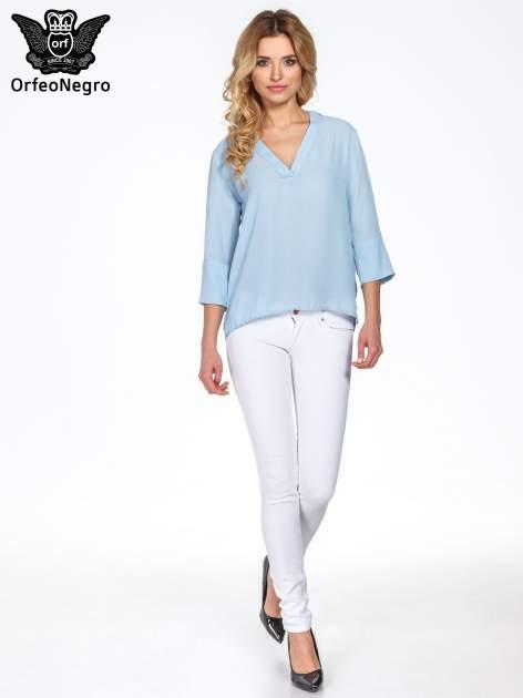 Jasnoniebieska koszula z dłuższym tyłem i rękawkami 3/4                                  zdj.                                  8