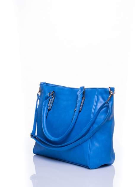 Jasnoniebieska miejska torba z ozdobnymi klamrami                                  zdj.                                  4