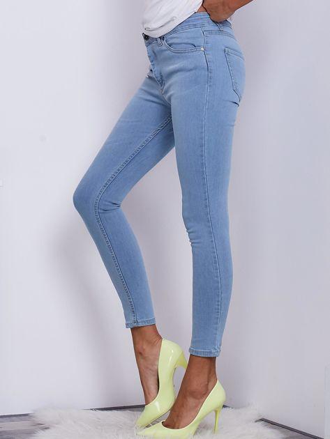 Jasnoniebieskie jeansowe spodnie ze stretchem                               zdj.                              3