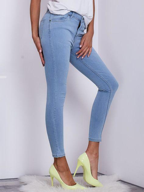 Jasnoniebieskie jeansowe spodnie ze stretchem                               zdj.                              5