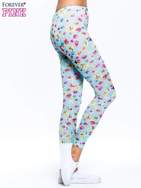 Jasnoniebieskie legginsy w kwiatki                                  zdj.                                  3