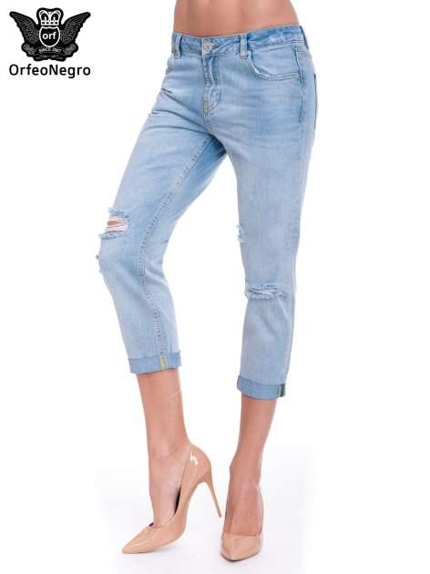 Jasnoniebieskie spodnie jeansowe 7/8  podwijaną nogawką                                  zdj.                                  1