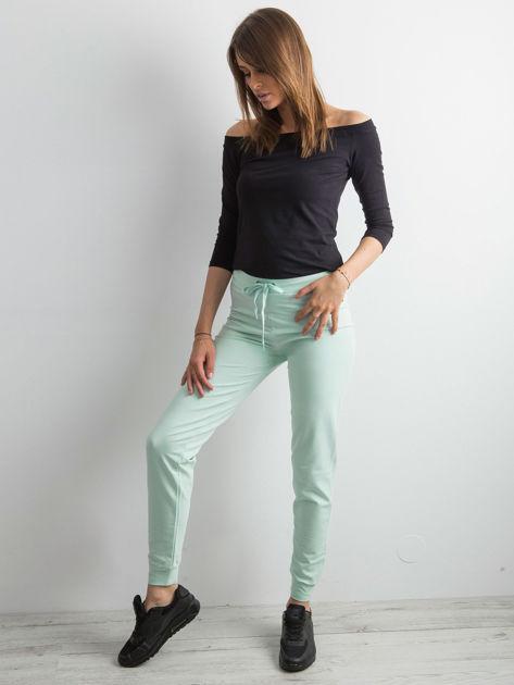 Jasnoturkusowe spodnie dresowe z troczkami                              zdj.                              4