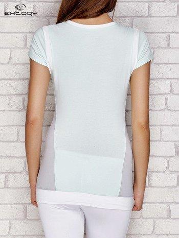 Jasnoturkusowy t-shirt z aplikacją