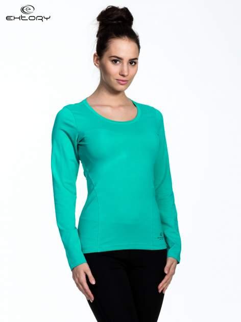 Jasnozielona bluzka sportowa z dekoltem U