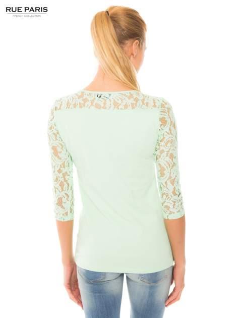 Jasnozielona bluzka z koronkowymi rękawami długości 3/4                                  zdj.                                  3