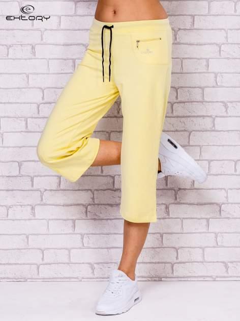Jasnożółte spodnie sportowe capri                                  zdj.                                  1