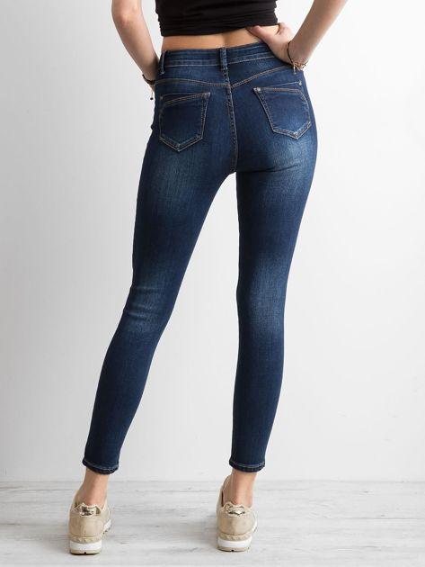 Jeansowe spodnie skinny z przetarciami niebieskie                              zdj.                              2