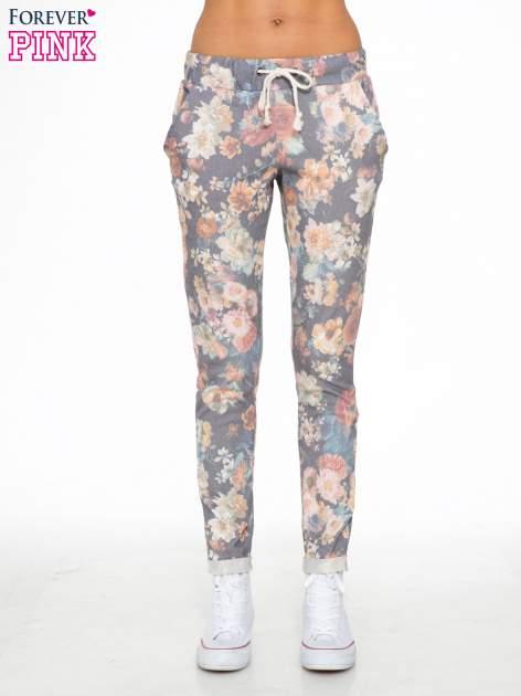 Kwiatowe spodnie dresowe ściągane w pasie