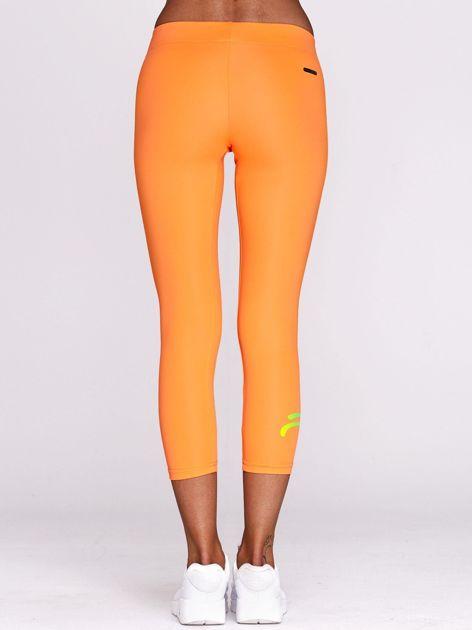 Legginsy do biegania z nadrukiem logo fluopomarańczowe                                  zdj.                                  3