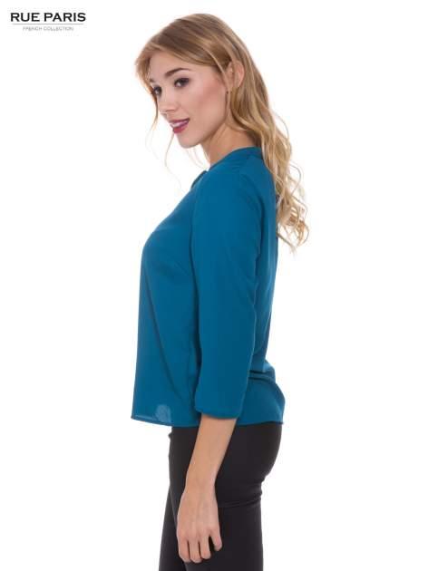 Lejąca turkusowa koszula z suwakiem na dekolcie                                  zdj.                                  2