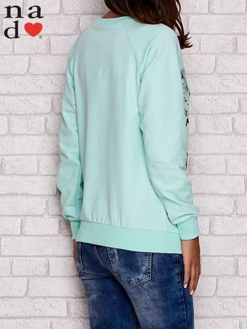 Miętowa bluza z kwiatowym nadrukiem                                  zdj.                                  4