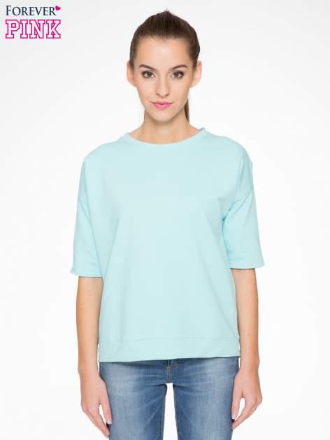 Miętowa bluza z suwakiem z tyłu                                  zdj.                                  1
