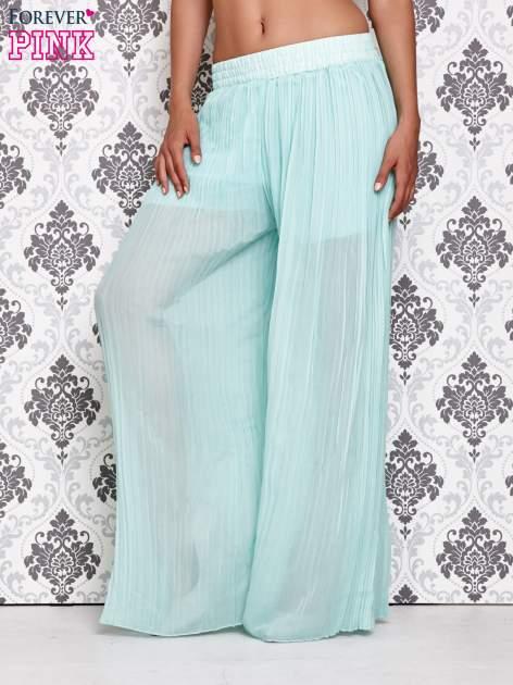 Miętowe plisowane spodnie palazzo                                   zdj.                                  1