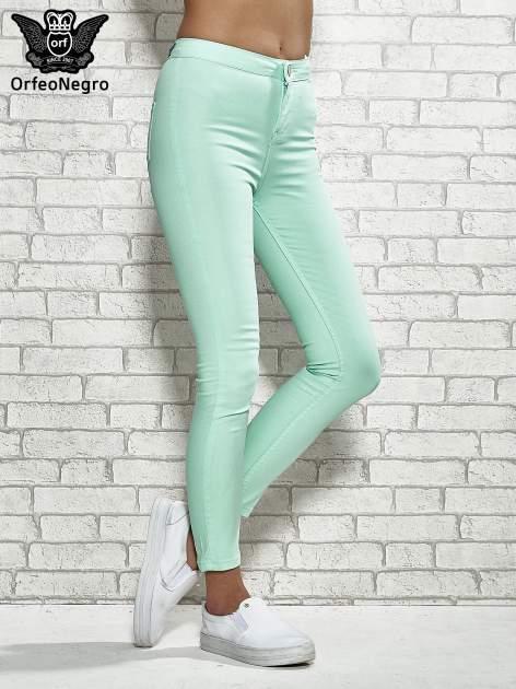 Miętowe spodnie rurki skinny