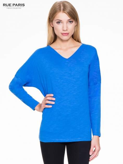Niebieska bluzka z wiązanym oczkiem z tyłu                                  zdj.                                  1