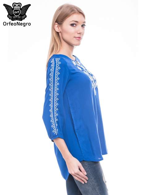 Niebieska luźna koszula z haftem                                  zdj.                                  3