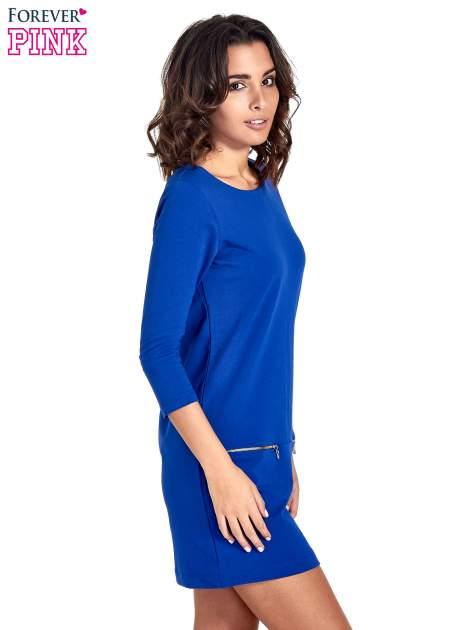 Niebieska sukienka ze złotymi suwakami                                  zdj.                                  3