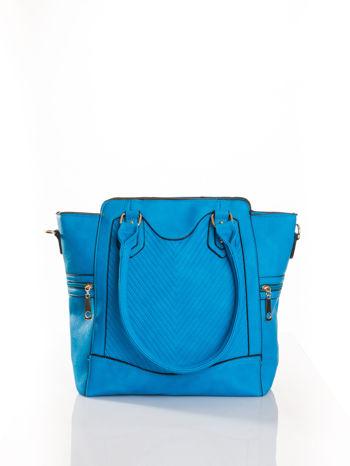 Niebieska torba ze złotymi wykończeniami                                  zdj.                                  1