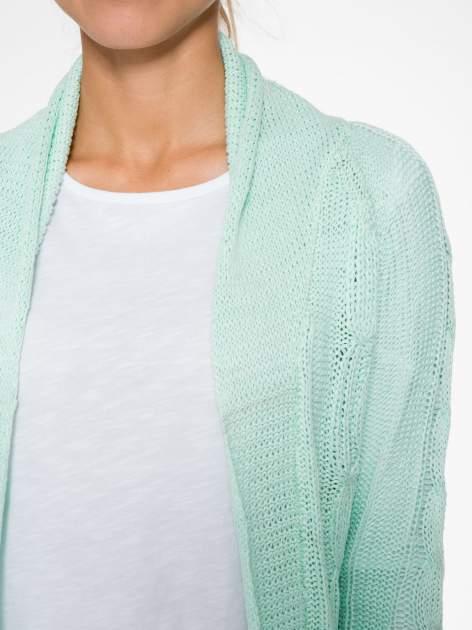 Niebieski ażurowy długi sweter typu kardigan z paskiem                                  zdj.                                  5
