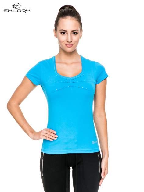 Niebieski damski t-shirt sportowy z dżetami                                  zdj.                                  1